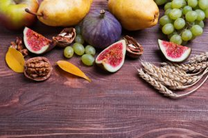Autumn fruits on wooden background close-up