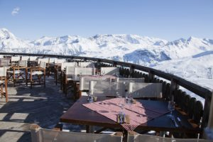 Restaurant terrace surrounded by snow covered mountains